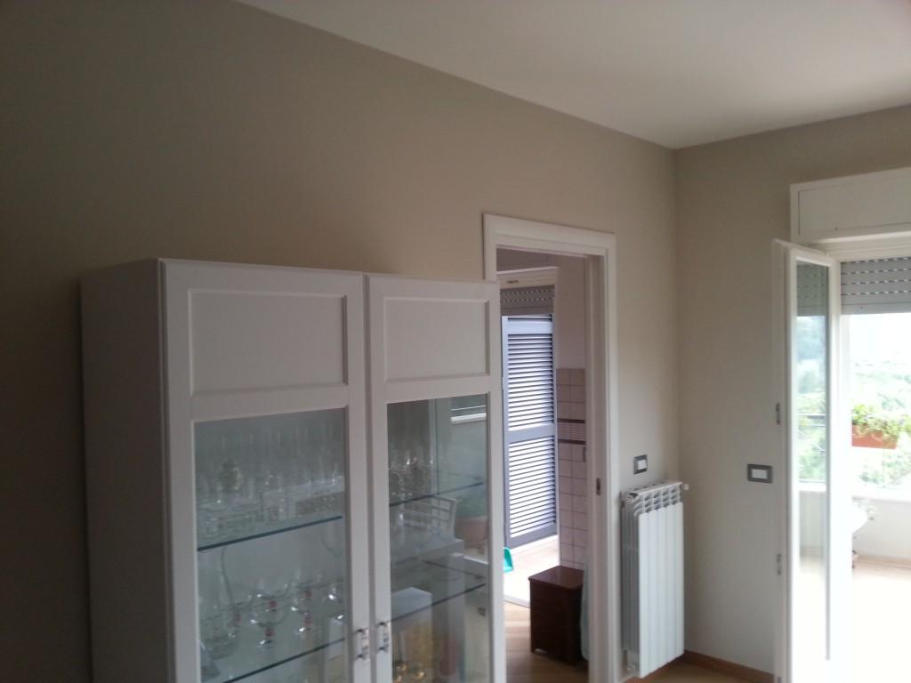Soggiorno gioia tortora the doctor creative for Pittura sabbiata pareti